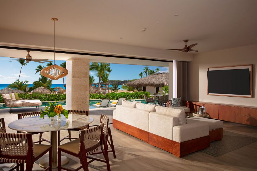 rustic, natural presidential suite living area with cozy seating and overlooking terrace