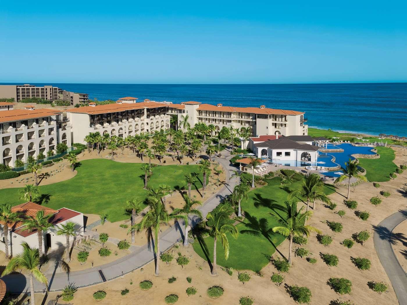 Aerial of luxury resort set in a desert surrounding along coastline