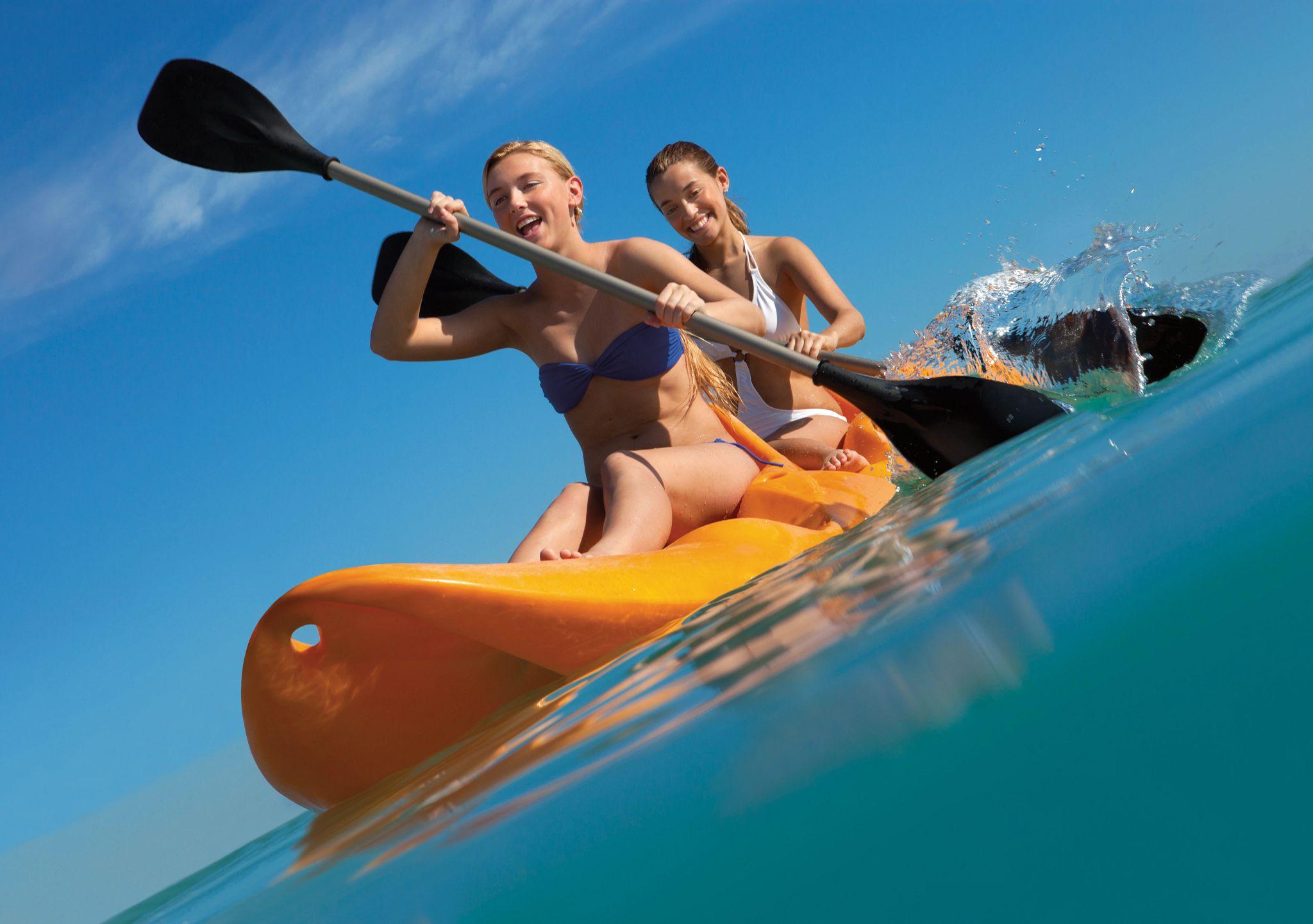 teens kayaking in the ocean