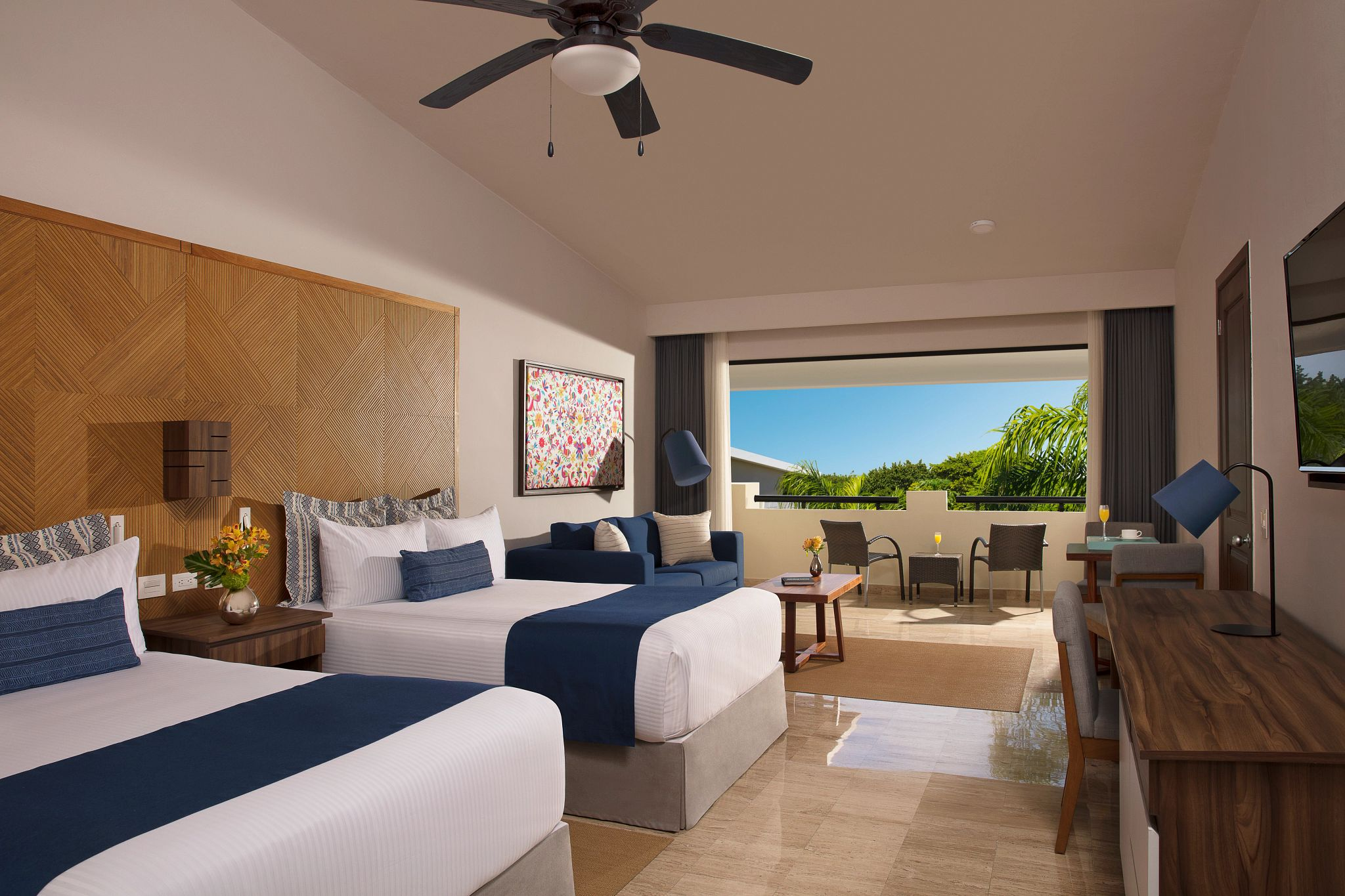Double bed hotel room with a tropical view