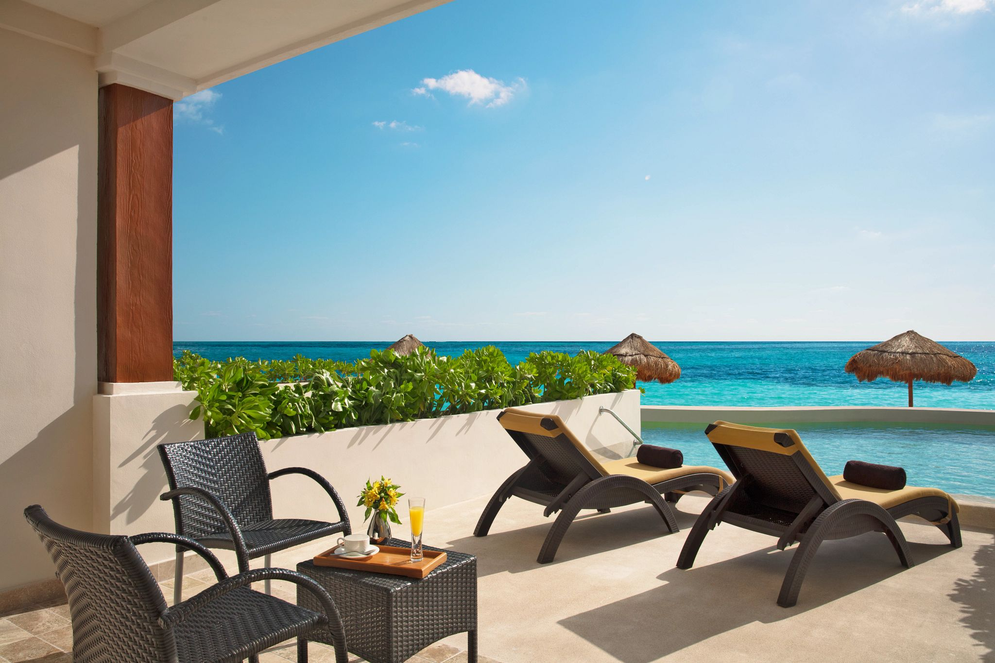 swim out terrace overlooking the ocean with lounge chairs