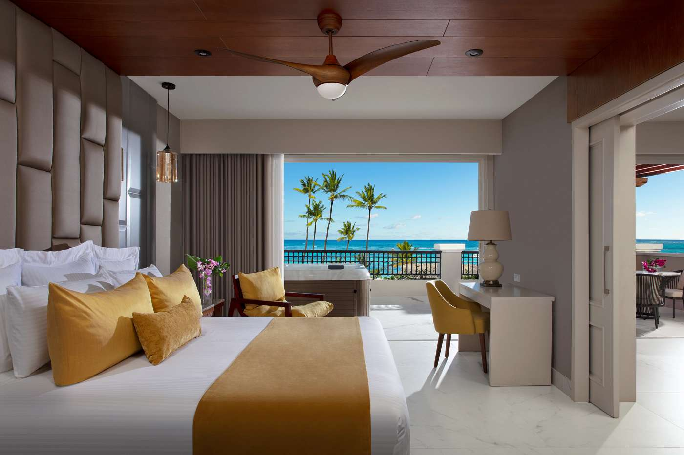 King bed room with ocean view whirlpool tub and palm trees