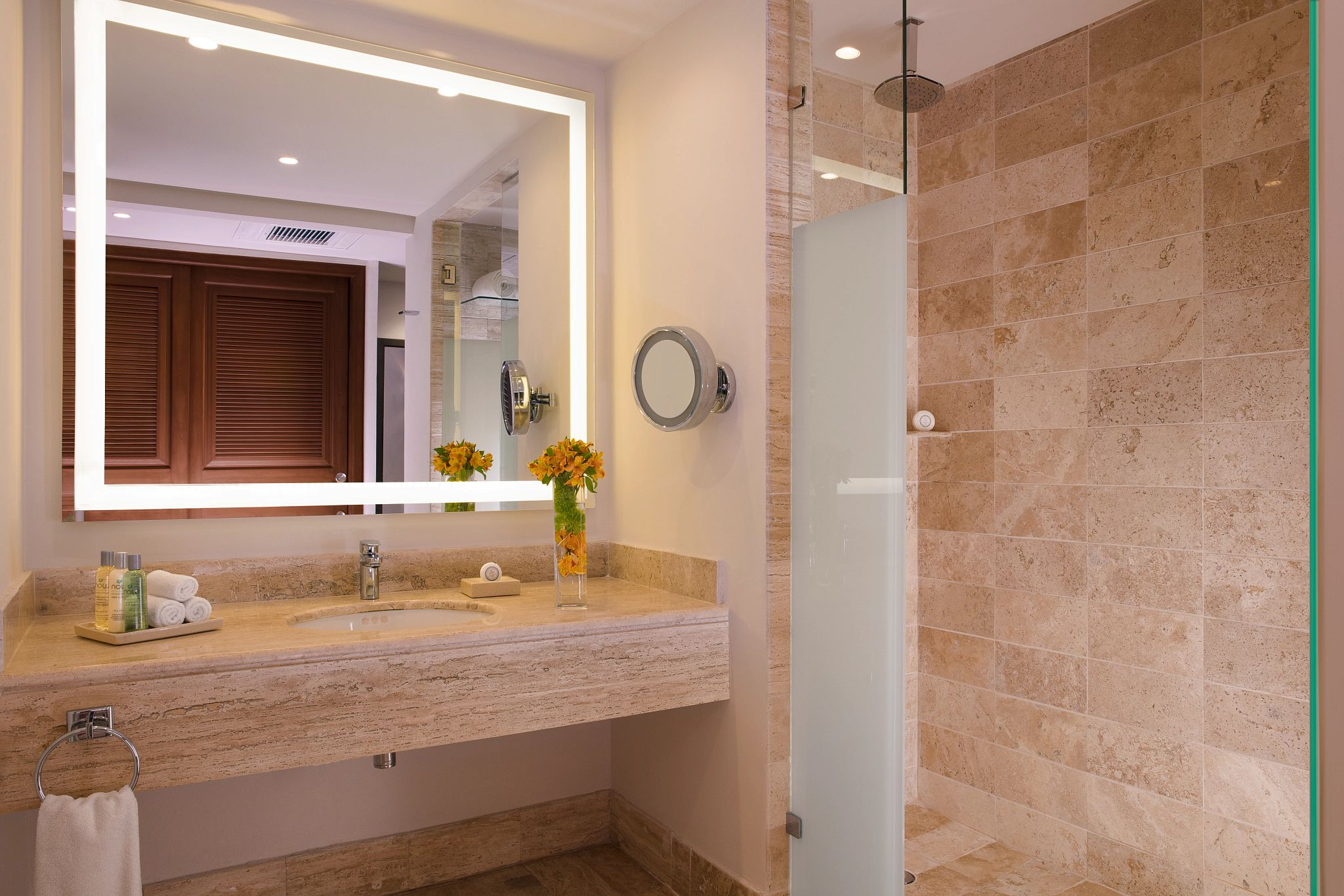 vanity of a bathroom with a large shower