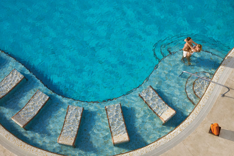 Family around plunge pool