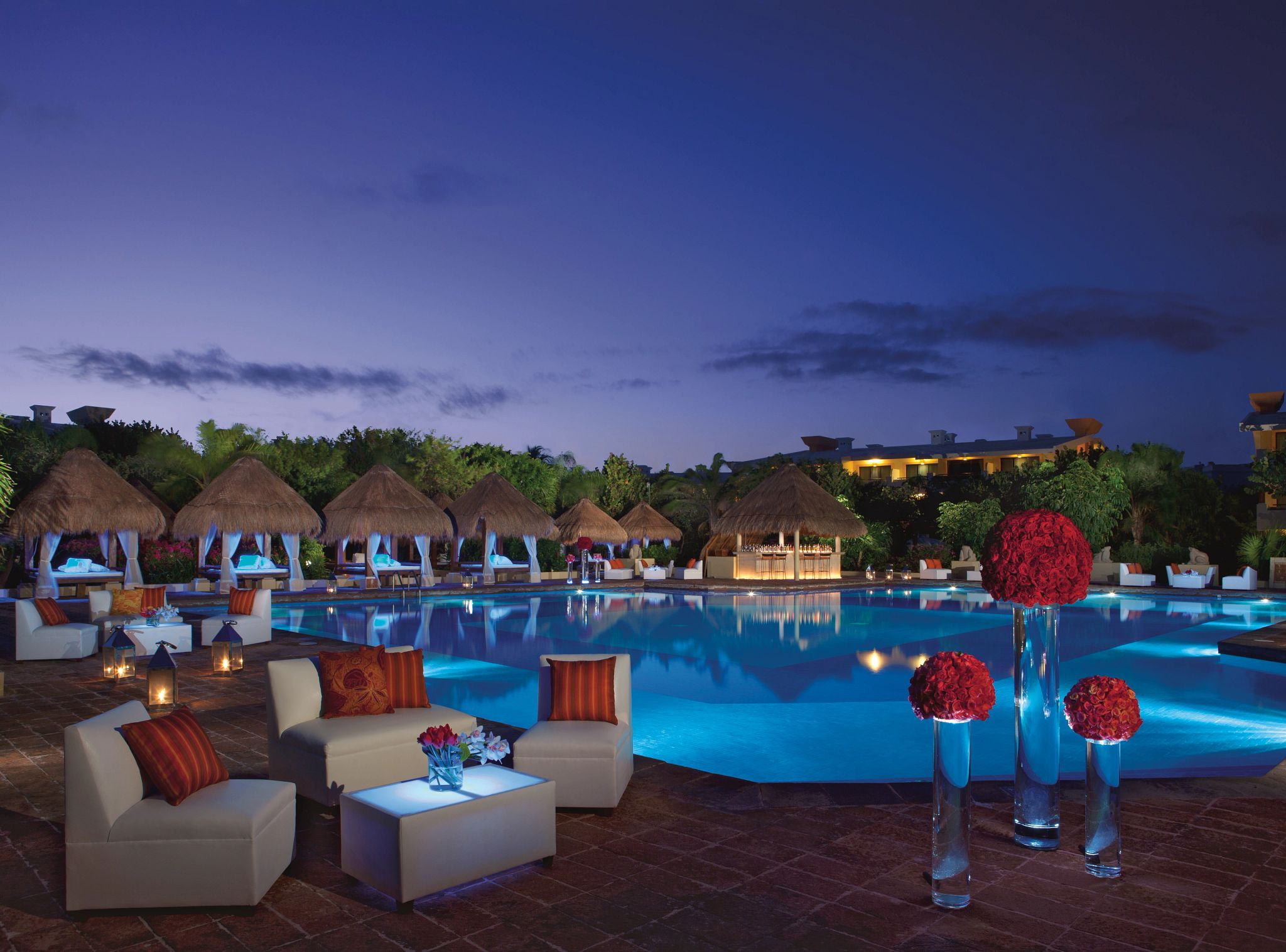 event set up by a swimming pool at night