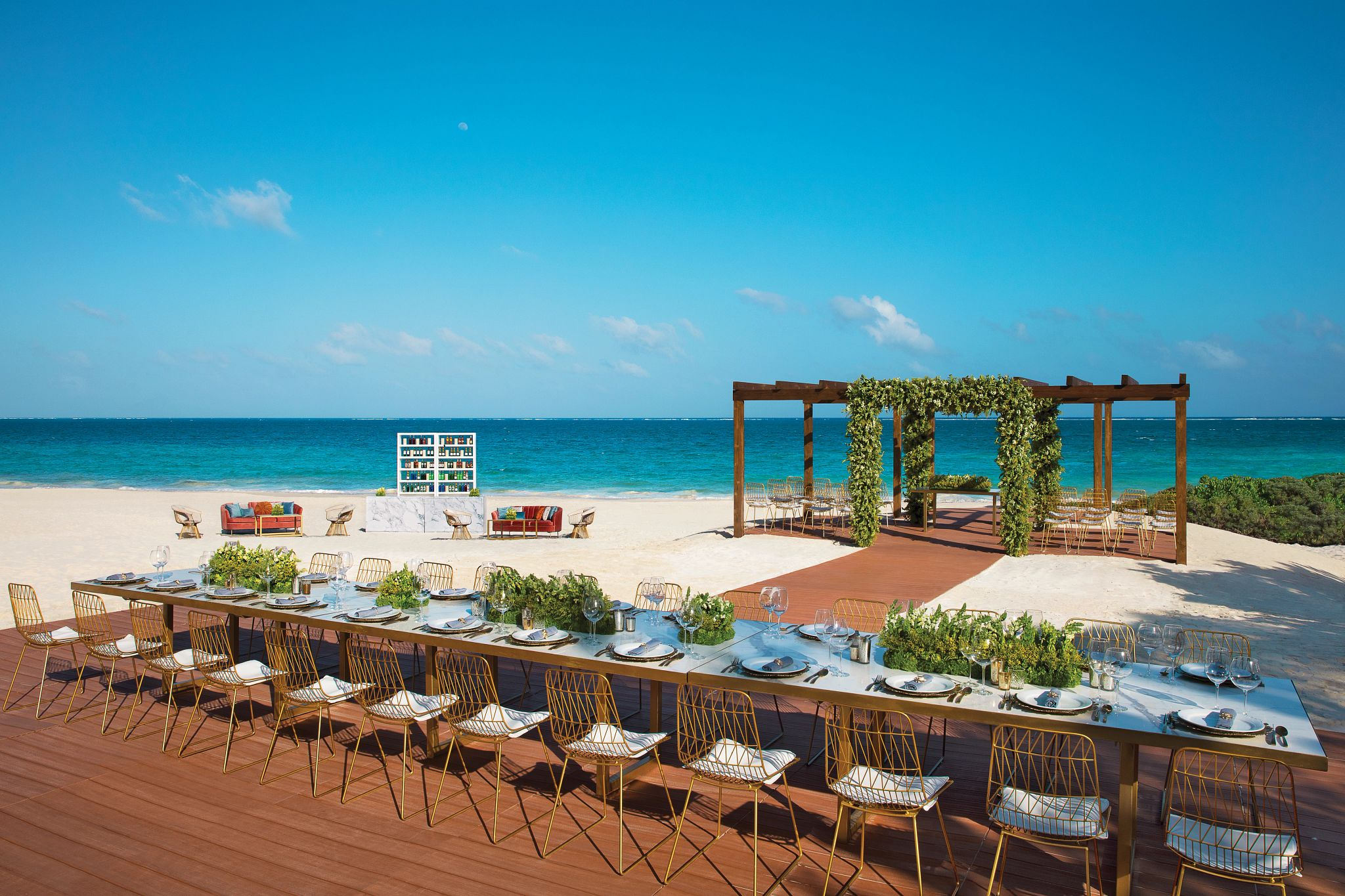 outdoor wedding terrace on the beach set up for a wedding reception
